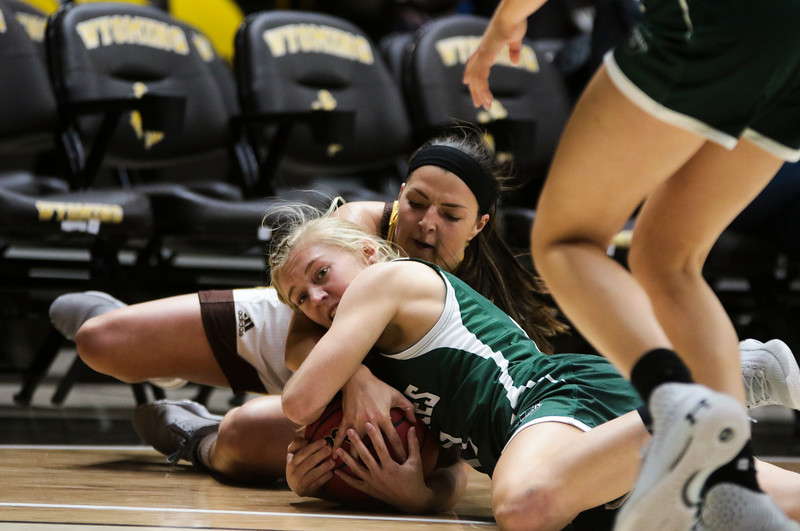 Cowgirls' Taylor Rusk fights a Grizzlies' player for the ball Friday, Nov. 1, 2019 at Arena-Auditorium. The Wyoming Cowgirls host the Adams State Grizzlies for the season's opening exhibition match. Nadav Soroker/Laramie Boomerang