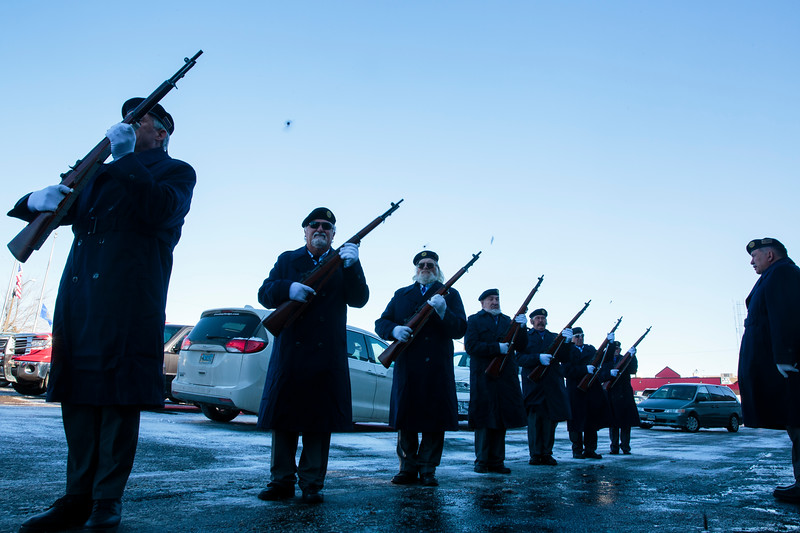 Shell casings fly as the American Legion Post 6 honor guard fires a 21-gun salute outside of the Cheyenne Veterans Day Ceremonies Monday, Nov. 11, 2019 at American Legion Post 6. Nadav Soroker/Wyoming Tribune Eagle