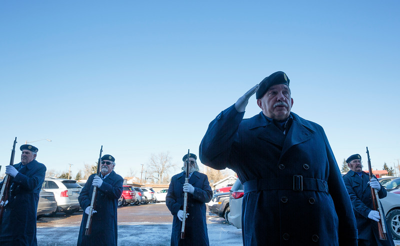 Bruce Koerwitz, a member of the American Legion Post 6 honor guard, salutes as the rest of the guard stands at attention outside of the Cheyenne Veterans Day Ceremonies Monday, Nov. 11, 2019 at American Legion Post 6. Nadav Soroker/Wyoming Tribune Eagle