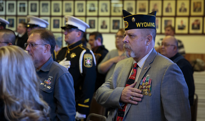 Doug Gumm, a veteran of the Army and Marine Corps, holds his hand over his heart during the Pledge of Allegiance as Cheyenne celebrates Veterans Day Monday, Nov. 11, 2019 at American Legion Post 6. Nadav Soroker/Wyoming Tribune Eagle