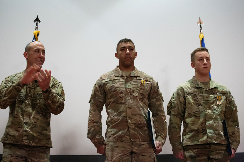 Col. Damian Schlussel, left, applauds Airmen First Class Christian Reid, center, and Cristopher Horton, security forces members at F.E. Warren, for saving a Nebraska family from a house fire during a patrol Friday, Nov. 15, 2019 at F.E. Warren. Nadav Soroker/Wyoming Tribune Eagle