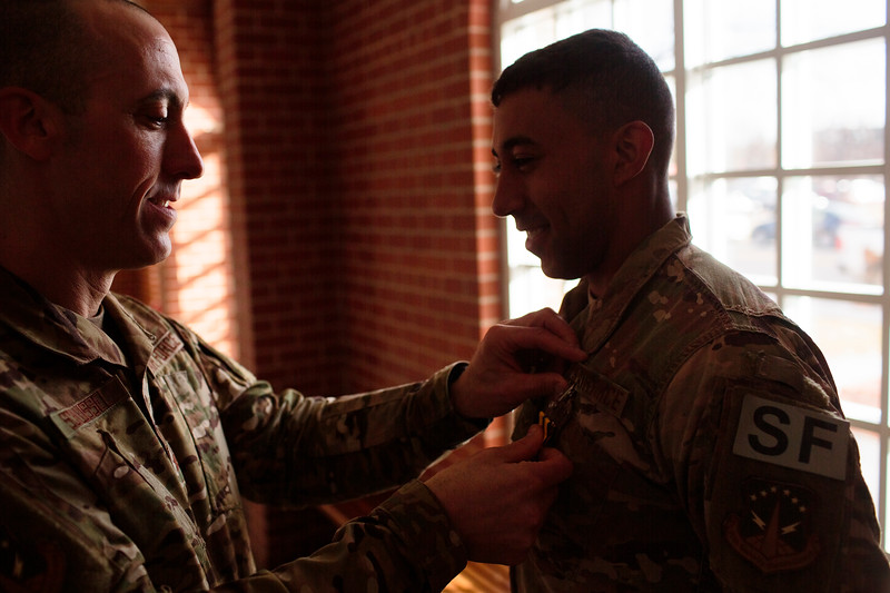 Col. Damian Schlussel, left, pins an Air Force Commendation Medal to Airman First Class Christian Reid, a security forces member at F.E. Warren, for saving a Nebraska family from a house fire during a patrol before a portrait Friday, Nov. 15, 2019 at F.E. Warren. Nadav Soroker/Wyoming Tribune Eagle
