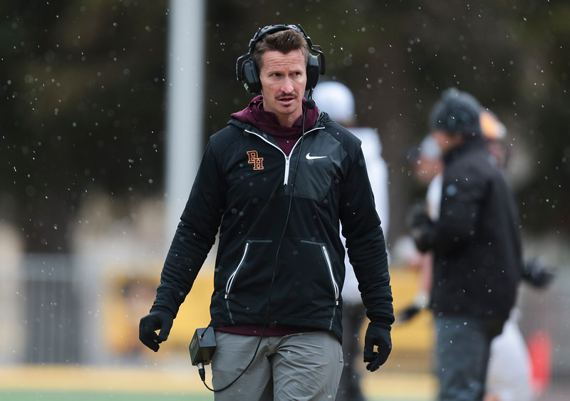 A Big Horn coach walks through the snow Saturday, Nov. 16, 2019 at War Memorial Stadium. Cokeville takes on Big Horn in the WHSAA 1A Championship match. Nadav Soroker/Wyoming Tribune Eagle