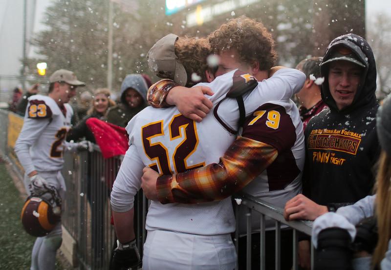 Big Horn's Gentry Lattin hugs supprters Saturday, Nov. 16, 2019 at War Memorial Stadium. Cokeville takes on Big Horn in the WHSAA 1A Championship match. Nadav Soroker/Wyoming Tribune Eagle