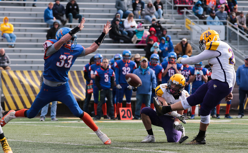 HEM's Shane McGraw blocks an extra point attempt in the WHSAA Six Man championship match between Little Snake River and HEM Saturday, Nov. 16, 2019 at War Memorial Stadium. The Rattlers defeated the Miners 71-38 to clinch the state championship. Nadav Soroker/Wyoming Tribune Eagle
