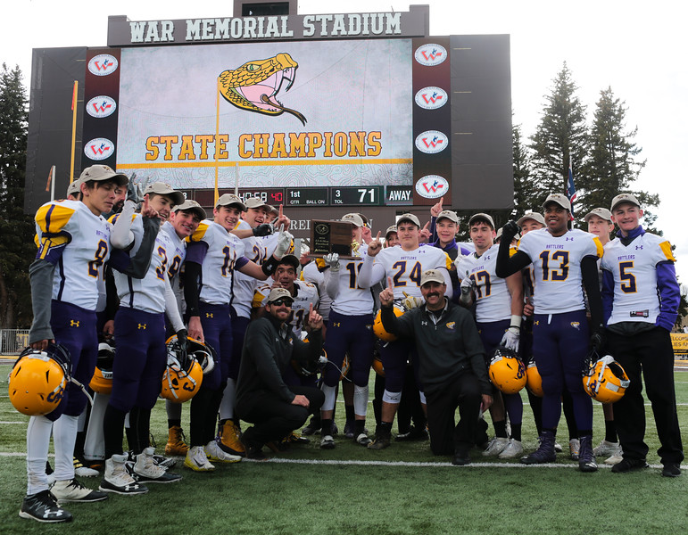The Little Snake River Rattlers pose with their trophy as the victors in the WHSAA Six Man championship match between Little Snake River and HEM Saturday, Nov. 16, 2019 at War Memorial Stadium. The Rattlers defeated the Miners 71-38 to clinch the state championship. Nadav Soroker/Wyoming Tribune Eagle