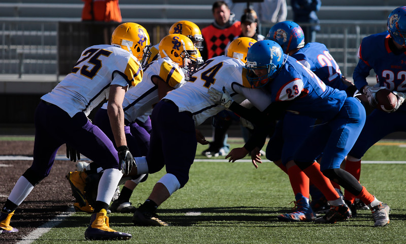 Little Snake River players and HEM players clash during an HEM possession in the WHSAA Six Man championship match between Little Snake River and HEM Saturday, Nov. 16, 2019 at War Memorial Stadium. The Rattlers defeated the Miners 71-38 to clinch the state championship. Nadav Soroker/Wyoming Tribune Eagle