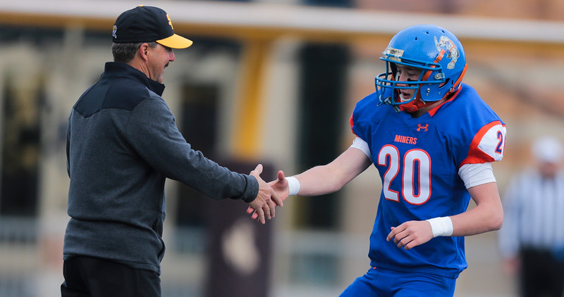 HEM's Conor McGraw shakes hands with a Little Snake River coach during the pregame in the WHSAA Six Man championship match between Little Snake River and HEM Saturday, Nov. 16, 2019 at War Memorial Stadium. The Rattlers defeated the Miners 71-38 to clinch the state championship. Nadav Soroker/Wyoming Tribune Eagle