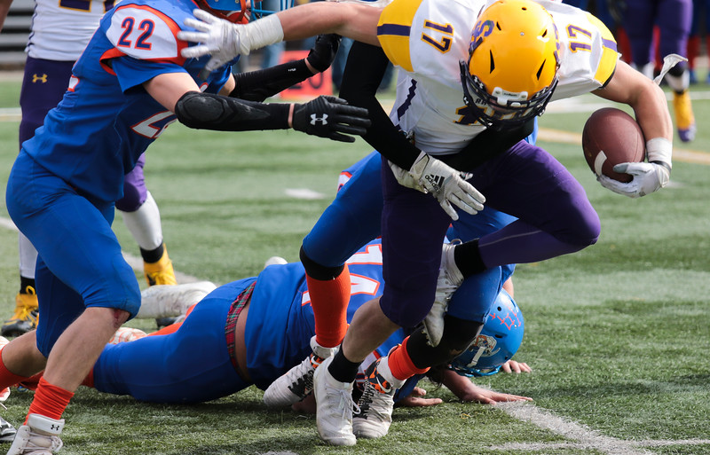 Little Snake River's Riggen Myers steps over a defender in the WHSAA Six Man championship match between Little Snake River and HEM Saturday, Nov. 16, 2019 at War Memorial Stadium. The Rattlers defeated the Miners 71-38 to clinch the state championship. Nadav Soroker/Wyoming Tribune Eagle