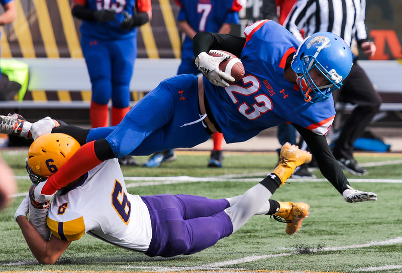 HEM's Devon Grosstick tries for as many yards as possible over a defender in the WHSAA Six Man championship match between Little Snake River and HEM Saturday, Nov. 16, 2019 at War Memorial Stadium. The Rattlers defeated the Miners 71-38 to clinch the state championship. Nadav Soroker/Wyoming Tribune Eagle