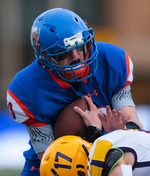 HEM's Shane McGraw weathers a tackle in the WHSAA Six Man championship match between Little Snake River and HEM Saturday, Nov. 16, 2019 at War Memorial Stadium. The Rattlers defeated the Miners 71-38 to clinch the state championship. Nadav Soroker/Wyoming Tribune Eagle
