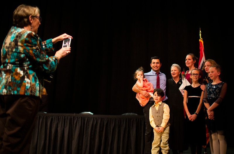 Engin Donmez, center left, takes a photo with U.S. District Judge Nancy Freudenthal and his family, Defne Donmez, 1, Kuzey Donmez, 4, Melissa Donmez, Mia Motch, 10, Maighan Motch, 12, and Jaida Brice, 12, after the naturalization ceremony for new United States Citizens Monday, Nov. 18, 2019 at Cheyenne South High School. Donmez, originally from Turkey, was one of seventeen new citizens from the ceremony. Nadav Soroker/Wyoming Tribune Eagle
