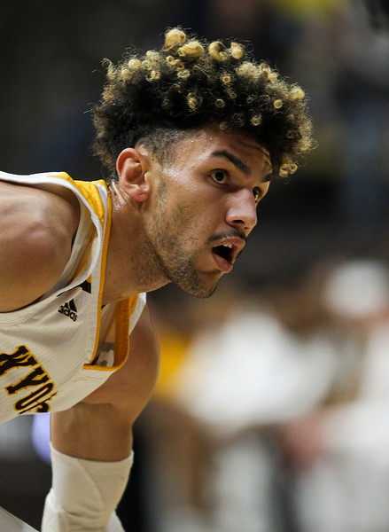 Wyoming guard Hunter Maldonado (24) looks for a  teammate Thursday, Nov. 21, 2019 at Arena-Auditorium. The Wyoming Cowboys defeated the Louisiana Ragin' Cajuns 69-61 in overtime. Nadav Soroker/Laramie Boomerang
