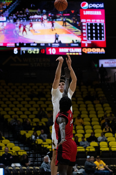 Wyoming forward Hunter Thompson (10) shoots a basket Thursday, Nov. 21, 2019 at Arena-Auditorium. The Wyoming Cowboys defeated the Louisiana Ragin' Cajuns 69-61 in overtime. Nadav Soroker/Laramie Boomerang
