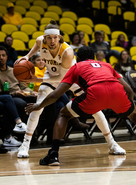 Wyoming guard Jake Hendricks (0) faces off again Louisiana guard Cedric Russell (0) Thursday, Nov. 21, 2019 at Arena-Auditorium. The Wyoming Cowboys defeated the Louisiana Ragin' Cajuns 69-61 in overtime. Nadav Soroker/Laramie Boomerang