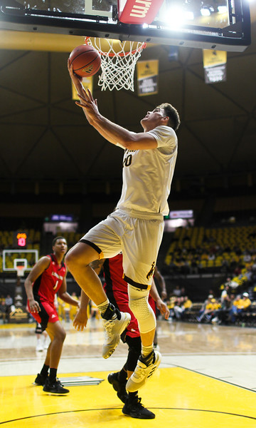 Wyoming forward Hunter Thompson (10) swings up under the basket for a 2-pointer Thursday, Nov. 21, 2019 at Arena-Auditorium. The Wyoming Cowboys defeated the Louisiana Ragin' Cajuns 69-61 in overtime. Nadav Soroker/Laramie Boomerang