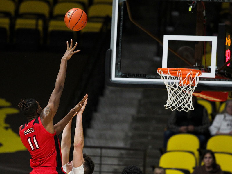 Louisiana forward Tirus Smith (11) tries for a shot over Wyoming forward Hunter Thompson (10) Thursday, Nov. 21, 2019 at Arena-Auditorium. The Wyoming Cowboys defeated the Louisiana Ragin' Cajuns 69-61 in overtime. Nadav Soroker/Laramie Boomerang
