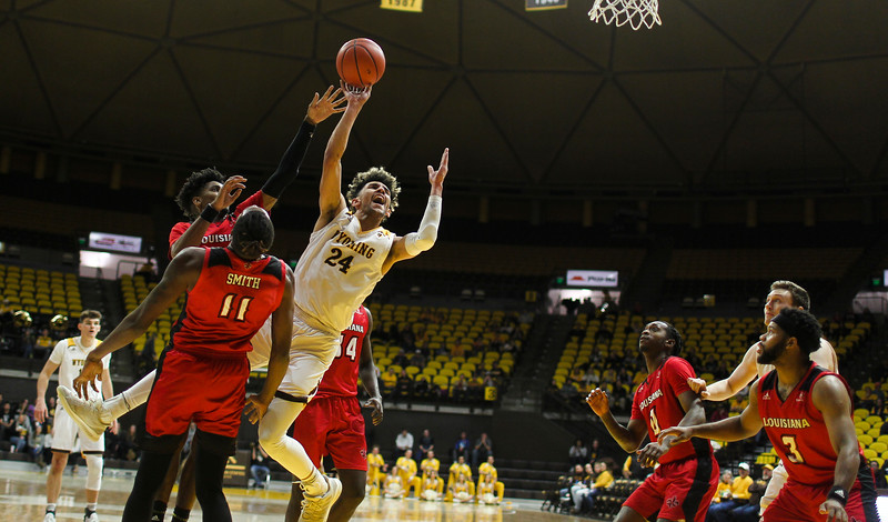 Wyoming guard Hunter Maldonado (24) is knocked over during a drive to the basket Thursday, Nov. 21, 2019 at Arena-Auditorium. The Wyoming Cowboys defeated the Louisiana Ragin' Cajuns 69-61 in overtime. Nadav Soroker/Laramie Boomerang