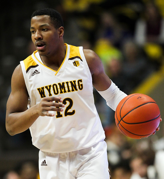Wyoming guard Greg Milton III (12) dribbles the ball Thursday, Nov. 21, 2019 at Arena-Auditorium. The Wyoming Cowboys defeated the Louisiana Ragin' Cajuns 69-61 in overtime. Nadav Soroker/Laramie Boomerang