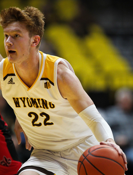 Wyoming guard Kenny Foster (22) dribbles up court Thursday, Nov. 21, 2019 at Arena-Auditorium. The Wyoming Cowboys defeated the Louisiana Ragin' Cajuns 69-61 in overtime. Nadav Soroker/Laramie Boomerang