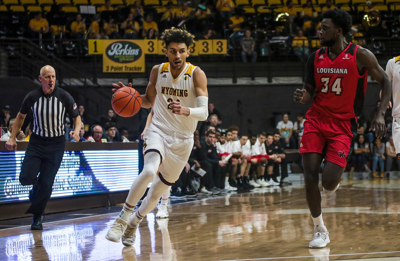 Wyoming guard Hunter Maldonado (24) dribbles up court Thursday, Nov. 21, 2019 at Arena-Auditorium. The Wyoming Cowboys defeated the Louisiana Ragin' Cajuns 69-61 in overtime. Nadav Soroker/Laramie Boomerang