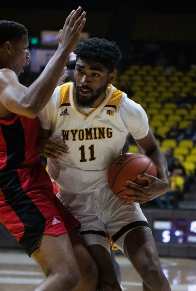 "Wyoming's Trevon ""TJ"" Taylor (11) muscles his way through a defender Thursday, Nov. 21, 2019 at Arena-Auditorium. The Wyoming Cowboys defeated the Louisiana Ragin' Cajuns 69-61 in overtime. Nadav Soroker/Laramie Boomerang"