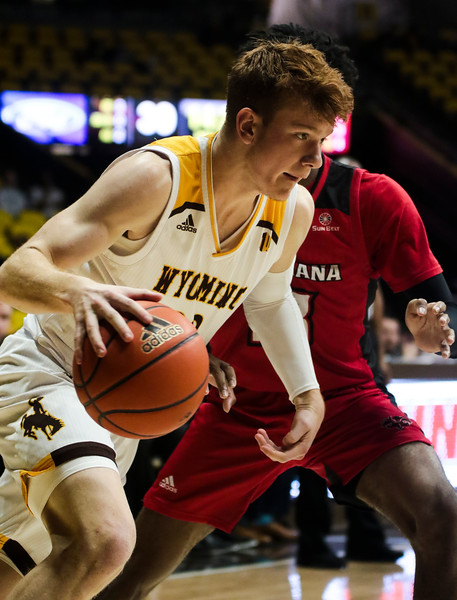 Wyoming guard Kenny Foster (22) dribbles under the basket Thursday, Nov. 21, 2019 at Arena-Auditorium. The Wyoming Cowboys defeated the Louisiana Ragin' Cajuns 69-61 in overtime. Nadav Soroker/Laramie Boomerang