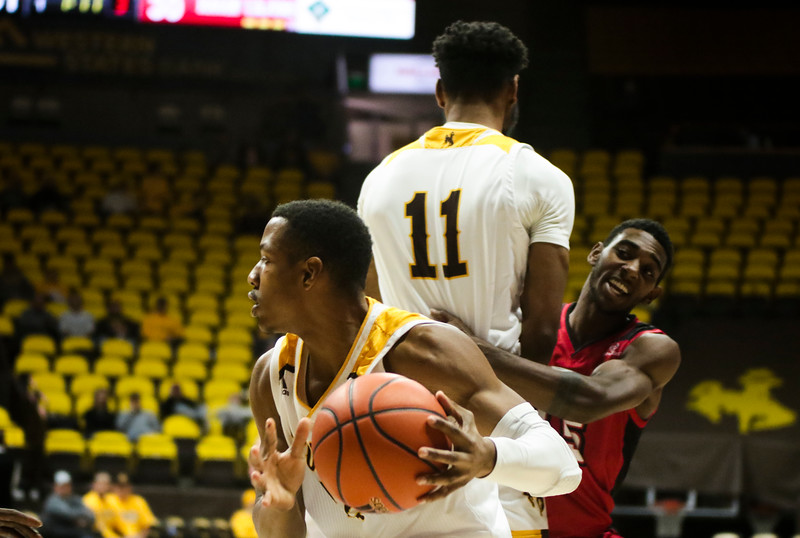 Wyoming guard Greg Milton III (12) looks for a shot Thursday, Nov. 21, 2019 at Arena-Auditorium. The Wyoming Cowboys defeated the Louisiana Ragin' Cajuns 69-61 in overtime. Nadav Soroker/Laramie Boomerang