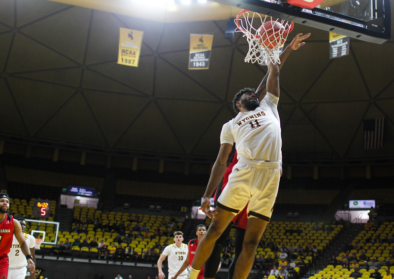 "Wyoming's Trevon ""TJ"" Taylor (11) dunks the ball Thursday, Nov. 21, 2019 at Arena-Auditorium. The Wyoming Cowboys defeated the Louisiana Ragin' Cajuns 69-61 in overtime. Nadav Soroker/Laramie Boomerang"