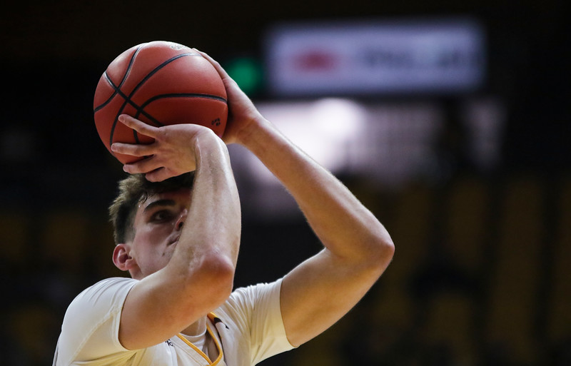 Wyoming forward Hunter Thompson (10) tries for a free-throw in overtime Thursday, Nov. 21, 2019 at Arena-Auditorium. The Wyoming Cowboys defeated the Louisiana Ragin' Cajuns 69-61 in overtime. Nadav Soroker/Laramie Boomerang