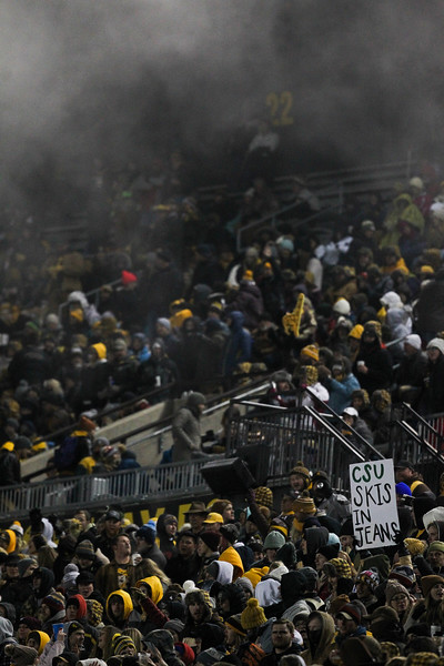 Wyoming fans cheer under steam from the stands Friday, Nov. 22, 2019 at War Memorial Stadium. The Wyoming Cowboys are tied with the Colorado State Rams 7-7 in the Border War. Nadav Soroker/Laramie Boomerang