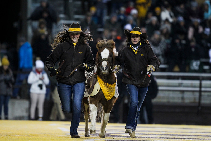 Cowboy Joe runs a victory lap after the Cowboys take the lead in the first half Friday, Nov. 22, 2019 at War Memorial Stadium. The Wyoming Cowboys are tied with the Colorado State Rams 7-7 in the Border War. Nadav Soroker/Laramie Boomerang