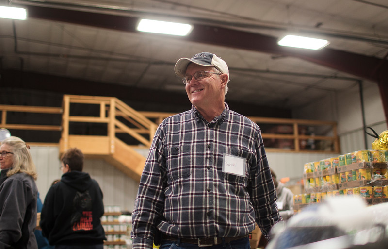 Darrell Schroeder, a volunteer at the St. Joseph's Food Pantry, hoists turkeys into the boxes given to about 450 families in need to help them get through Thanksgiving  Monday, Nov. 25, 2019 at the St. Joseph's Food Pantry. The Turkey Boxes come with the bird, as well as all the fixings to get through Thanksgiving, and are made with donations from big groups like Albertsons, Spradley Barr and the St. Mary's Youth Group, as well as from smaller groups and individuals, according to Pantry Coordinator Renee Gamino. Nadav Soroker/Wyoming Tribune Eagle