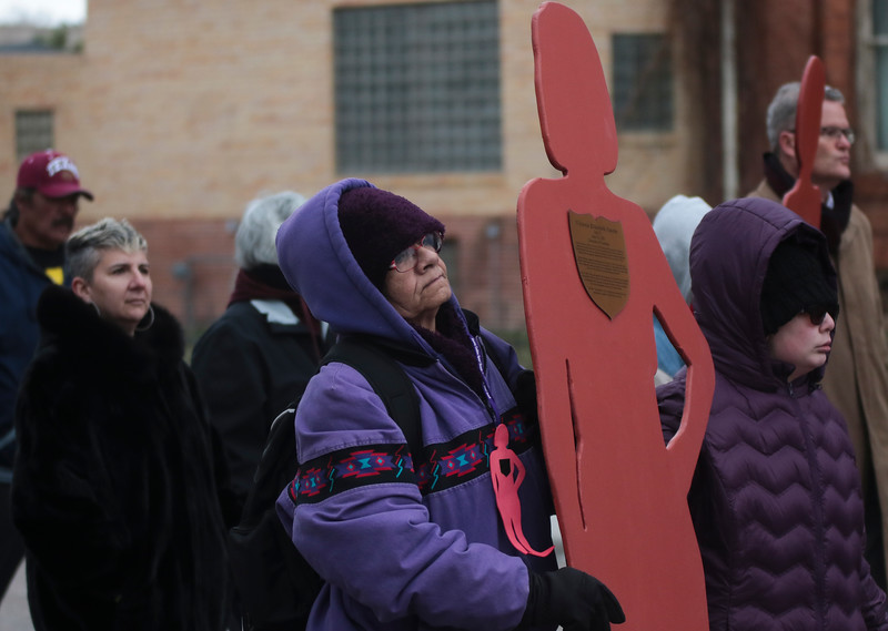Elizabeth Juarez carries the silhouette representing her daughter Victoria Juarez, a victim of domestic violence, in the Silent Witness March from the Capitol Building to the Laramie County Library Monday, Nov. 25, 2019 in Cheyenne. The March, organized by the Zonta Club of Cheyenne, was arranged to bring awareness to the problems of domestic and gender violence in Laramie County. Nadav Soroker/Wyoming Tribune Eagle