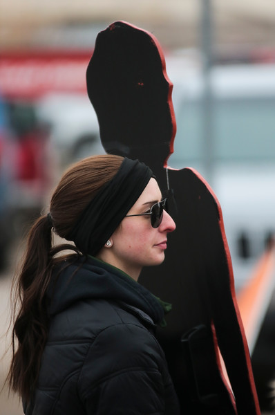 Jessica Lesley, a Laramie County deputy coroner,  carries the silhouette of a Laramie County domestic violence victim in the Silent Witness March from the Capitol Building to the Laramie County Library Monday, Nov. 25, 2019 in Cheyenne. The March, organized by the Zonta Club of Cheyenne, was arranged to bring awareness to the problems of domestic and gender violence in Laramie County. Nadav Soroker/Wyoming Tribune Eagle