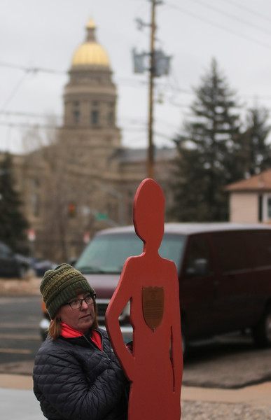Kristi Wilson, the president of Zonta Club of Cheyenne, carries the silhouette of a victim of domestic violence, in the Silent Witness March from the Capitol Building to the Laramie County Library Monday, Nov. 25, 2019 in Cheyenne. The March, organized by the Zonta Club of Cheyenne, was arranged to bring awareness to the problems of domestic and gender violence in Laramie County. Nadav Soroker/Wyoming Tribune Eagle