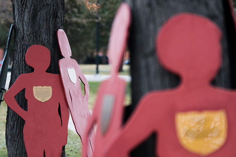 Silhouettes of domestic violence victims lean against trees while waiting for marchers to carry them in the Silent Witness March from the Capitol Building to the Laramie County Library Monday, Nov. 25, 2019 in Cheyenne. The March, organized by the Zonta Club of Cheyenne, was arranged to bring awareness to the problems of domestic and gender violence in Laramie County. Nadav Soroker/Wyoming Tribune Eagle