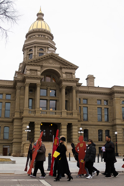 The Silent Witness March passes the Capitol Building while carrying silhouettes of Laramie County domestic violence victims, on their way to the Library Monday, Nov. 25, 2019 in Cheyenne. The March, organized by the Zonta Club of Cheyenne, was arranged to bring awareness to the problems of domestic and gender violence in Laramie County. Nadav Soroker/Wyoming Tribune Eagle