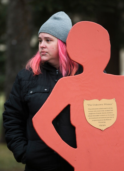 """Robin Kus carries a silhouette representing """"The Unknown Woman"""" among domestic violence victims in the Silent Witness March from the Capitol Building to the Laramie County Library Monday, Nov. 25, 2019 in Cheyenne. The March, organized by the Zonta Club of Cheyenne, was arranged to bring awareness to the problems of domestic and gender violence in Laramie County. Nadav Soroker/Wyoming Tribune Eagle"""