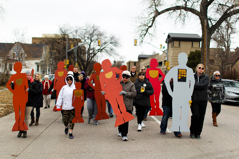 Participants in the Silent Witness March carry silhouettes of Laramie County domestic violence victims, on their way to the Library Monday, Nov. 25, 2019 in Cheyenne. The March, organized by the Zonta Club of Cheyenne, was arranged to bring awareness to the problems of domestic and gender violence in Laramie County. Nadav Soroker/Wyoming Tribune Eagle