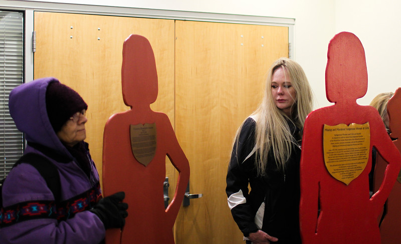 Aimie Hansen looks over at Elizabeth Juarez as they wait to place the silhouettes of Laramie County domestic violence victims on display Monday, Nov. 25, 2019 in the Laramie County Library. The silhouettes, which bear the stories of the victims they represent, will be on display for the next sixteen days to bring awareness to the issue of domestic and gender-based violence. Nadav Soroker/Wyoming Tribune Eagle