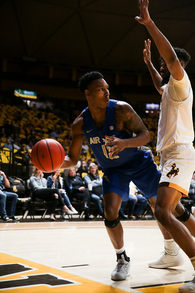 Air Force forward Lavelle Scottie (12) looks for an open teammate, Wednesday, Dec. 4, 2019 in Arena-Auditorium. University of Wyoming Mens Basketball lose to Air Force Academy 86-77. Nadav Soroker/Laramie Boomerang