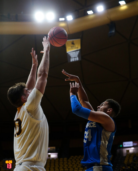 Air Force center Ryan Swan (34) attempts a shot ove3r Wyoming forward Hunter Thompson (10), Wednesday, Dec. 4, 2019 in Arena-Auditorium. University of Wyoming Mens Basketball lose to Air Force Academy 86-77. Nadav Soroker/Laramie Boomerang