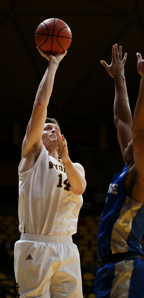 Wyoming forward Austin Mueller (14) attempts a shot as the University of Wyoming Mens Basketball hosts Air Force Academy, Wednesday, Dec. 4, 2019 in Arena-Auditorium. Nadav Soroker/Laramie Boomerang