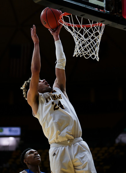 Wyoming guard Hunter Maldonado (24) puts in a basket, Wednesday, Dec. 4, 2019 in Arena-Auditorium. University of Wyoming Mens Basketball lose to Air Force Academy 86-77. Nadav Soroker/Laramie Boomerang