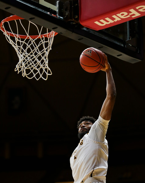 "Wyoming's Trevon ""TJ"" Taylor (11) slams in a dunk, Wednesday, Dec. 4, 2019 in Arena-Auditorium. University of Wyoming Mens Basketball lose to Air Force Academy 86-77. Nadav Soroker/Laramie Boomerang"
