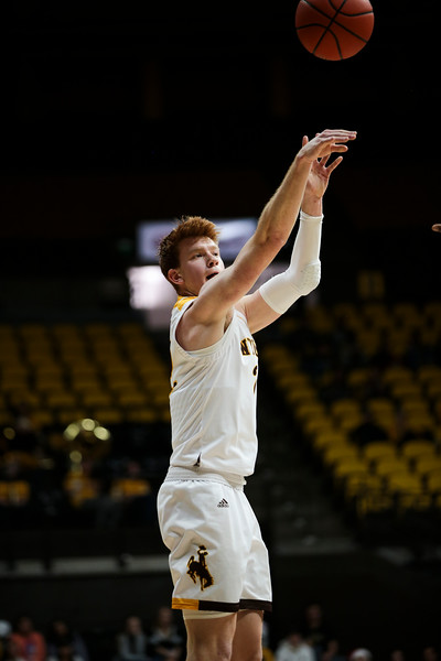 Wyoming guard Kenny Foster (22) attempts a three-pointer, Wednesday, Dec. 4, 2019 in Arena-Auditorium. University of Wyoming Mens Basketball lose to Air Force Academy 86-77. Nadav Soroker/Laramie Boomerang