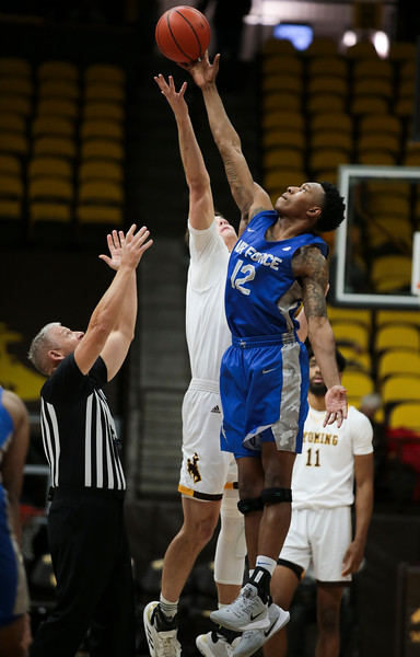 Air Force forward Lavelle Scottie (12) snags the tipoff from Wyoming forward Hunter Thompson (10), Wednesday, Dec. 4, 2019 in Arena-Auditorium.University of Wyoming Mens Basketball hosts Air Force Academy. Nadav Soroker/Laramie Boomerang