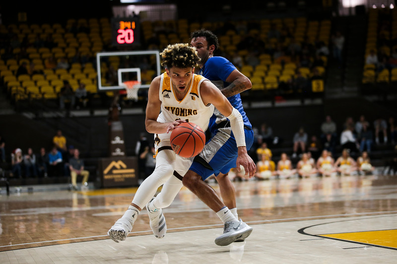 Wyoming guard Hunter Maldonado (24) drives up the court, Wednesday, Dec. 4, 2019 in Arena-Auditorium. University of Wyoming Mens Basketball lose to Air Force Academy 86-77. Nadav Soroker/Laramie Boomerang