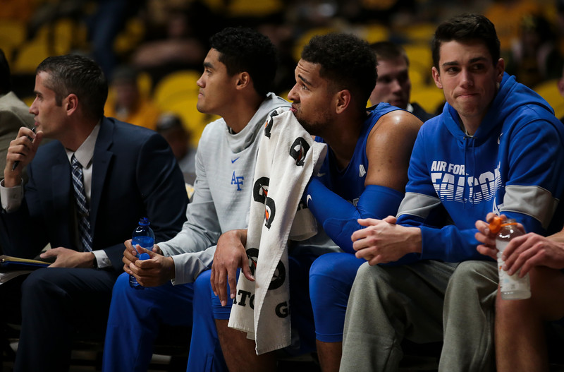 Air Force center Ryan Swan (34) wipes his face while watching the action from the bench as University of Wyoming Mens Basketball hosts Air Force Academy, Wednesday, Dec. 4, 2019 in Arena-Auditorium. Nadav Soroker/Laramie Boomerang